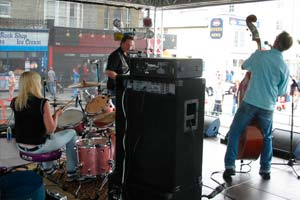 drummer and double-bassist on stage at street festival