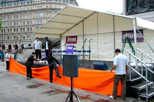 outside stage with microphone and chairs in trafalgar square